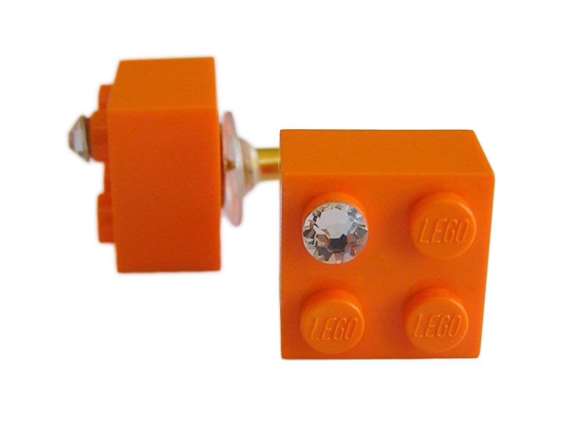 Orange LEGO® brick 2x2 with a 'Diamond' color SWAROVSKI® crystal on a Gold plated stud/silicone back stopper