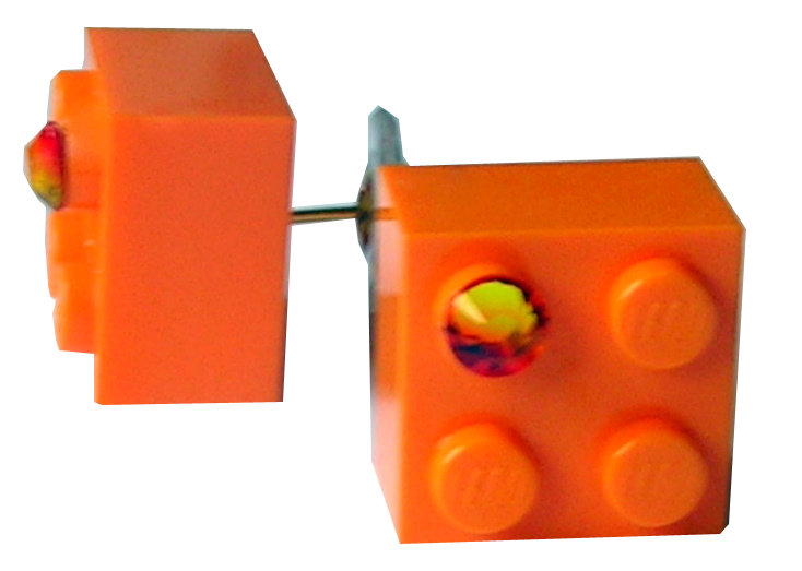 Orange LEGO® brick 2x2 with an Orange SWAROVSKI® crystal on a Gold plated stud/silicone back stopper