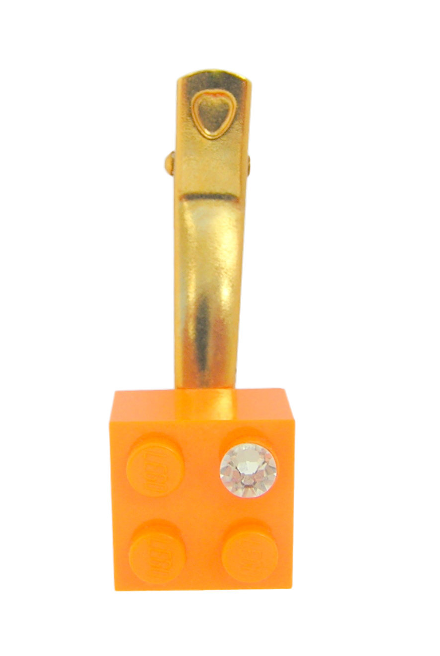 ​Orange LEGO® brick 2x2 with a 'Diamond' color SWAROVSKI® crystal on a Gold plated hair clip (one piece)