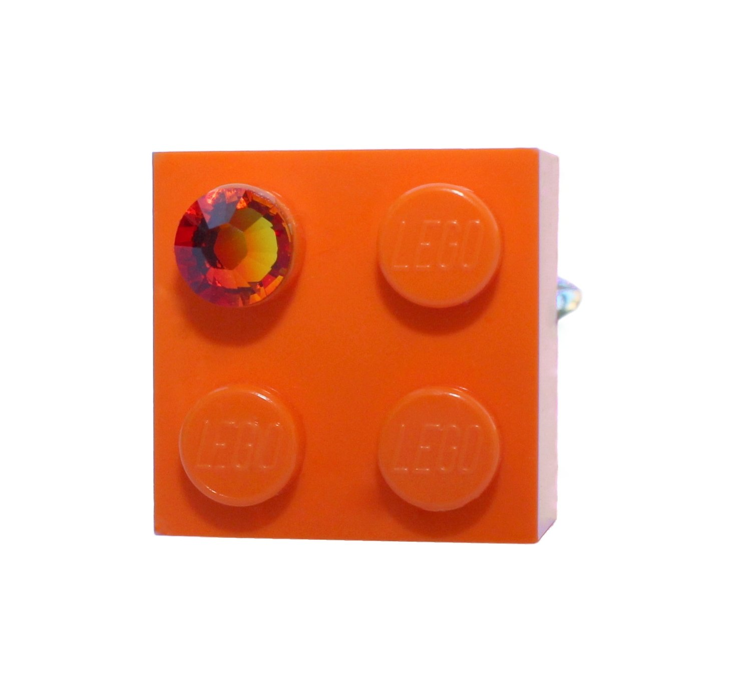 ​Orange LEGO® brick 2x2 with an Orange SWAROVSKI® crystal on a Silver plated adjustable ring ​finding