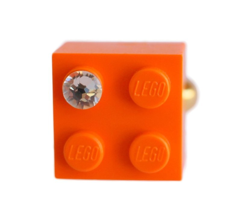 ​Orange LEGO® brick 2x2 with a 'Diamond' color SWAROVSKI® crystal on a Gold plated adjustable ring finding