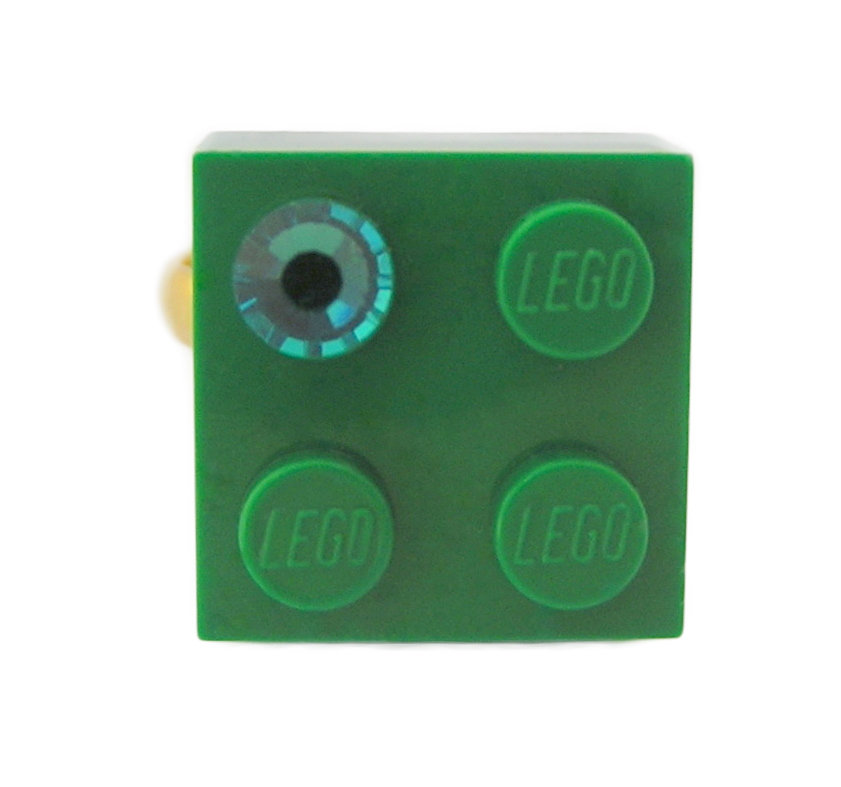 ​Dark Green LEGO® brick 2x2 with a Green SWAROVSKI® crystal on a Gold plated adjustable ring finding