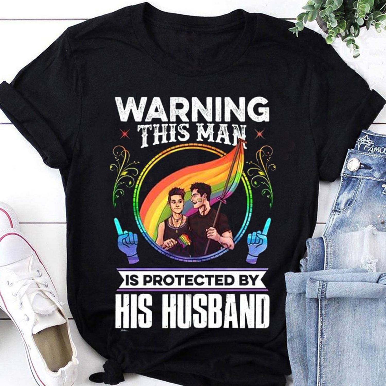 Warning This Man Is Protected By His Husband LGBT shirt,Lgbt Pride shirt,Love is love shirt,Lgbtq Tee,Gay Pride Gift,Lesbian Matching Trending Unisex Hoodies Sweatshirt Long Sleeve V Neck Kid T Shirt