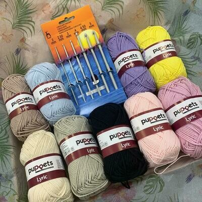 Crochet Art 'iSewlation' craft package including 9 balls of wool and one set of assorted crochet hooks