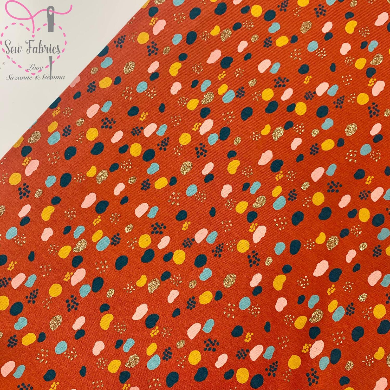 John Louden Rust Drops Print Cotton Elastane Glitter Jersey Fabric