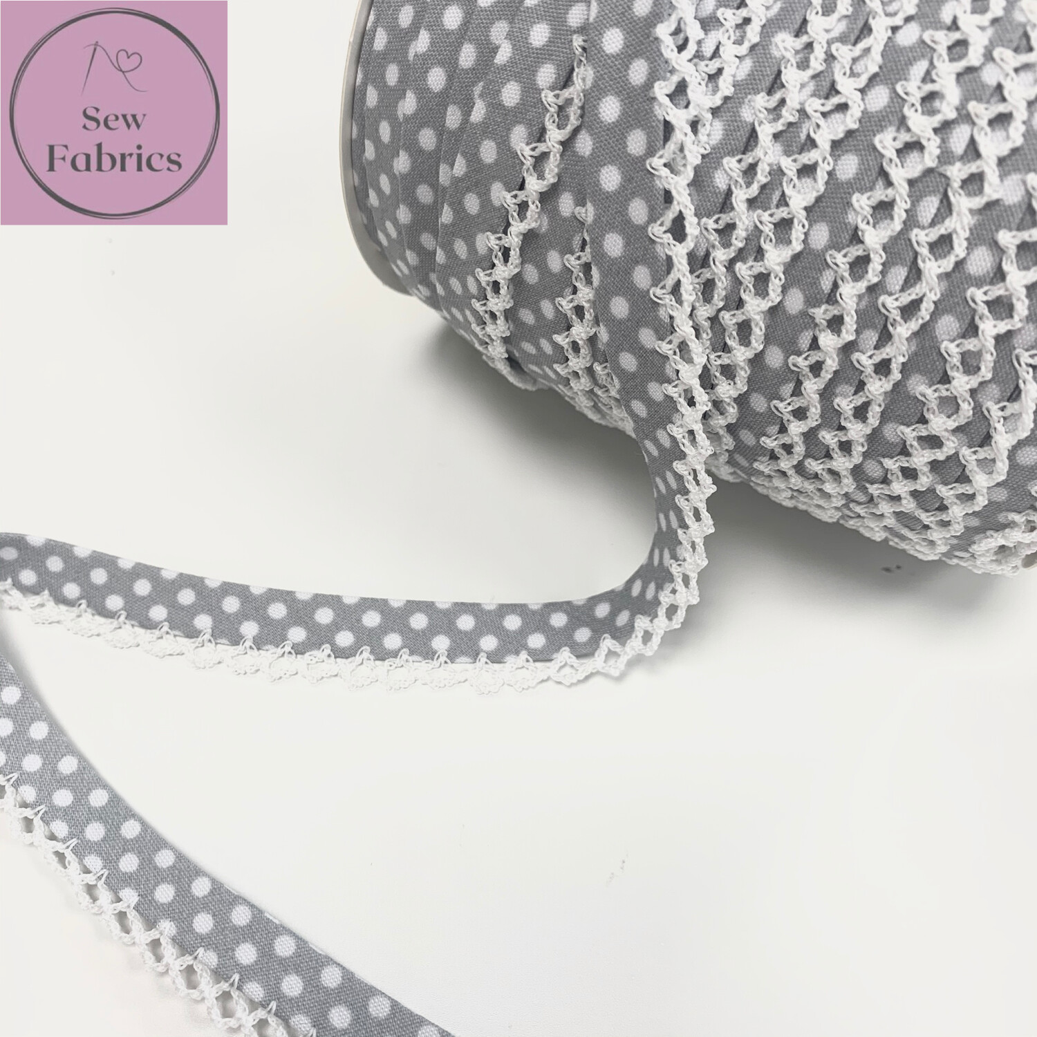 12mm Grey with White Polka Dots Pre-Folded Bias Binding with Lace Edge.