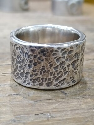 Thick Hammered 925 Sterling silver band.