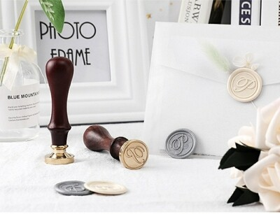 An alphabe  Wax Seal Stamp kit A -Z