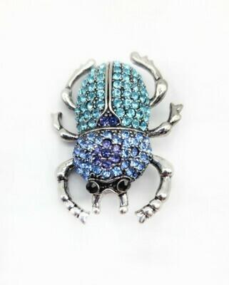 Broche scarabée sertie de strass