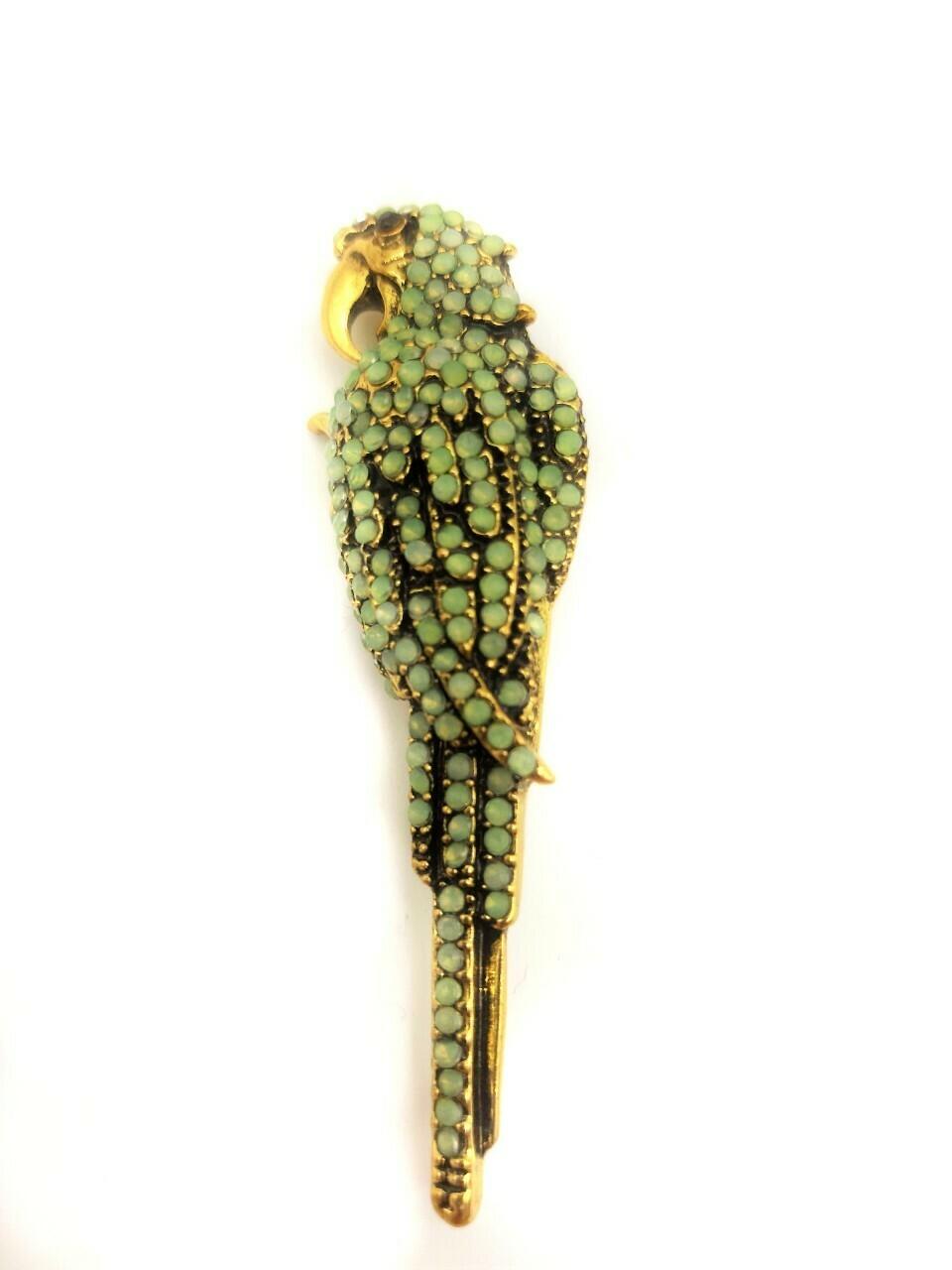 Broche perroquet sertie