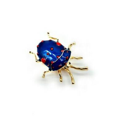 petit coléoptère bleu et rouge