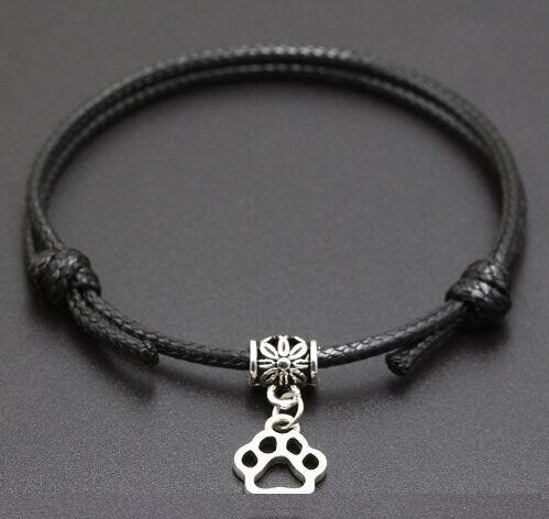 A BEAUTIFUL BLACK PAW PRINT CORD BRACELET
