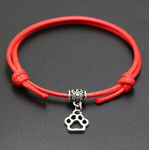 A BEAUTIFUL RED PAW PRINT CORD BRACELET