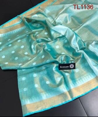 Green shade tissue linen temple border Saree with butta weaving