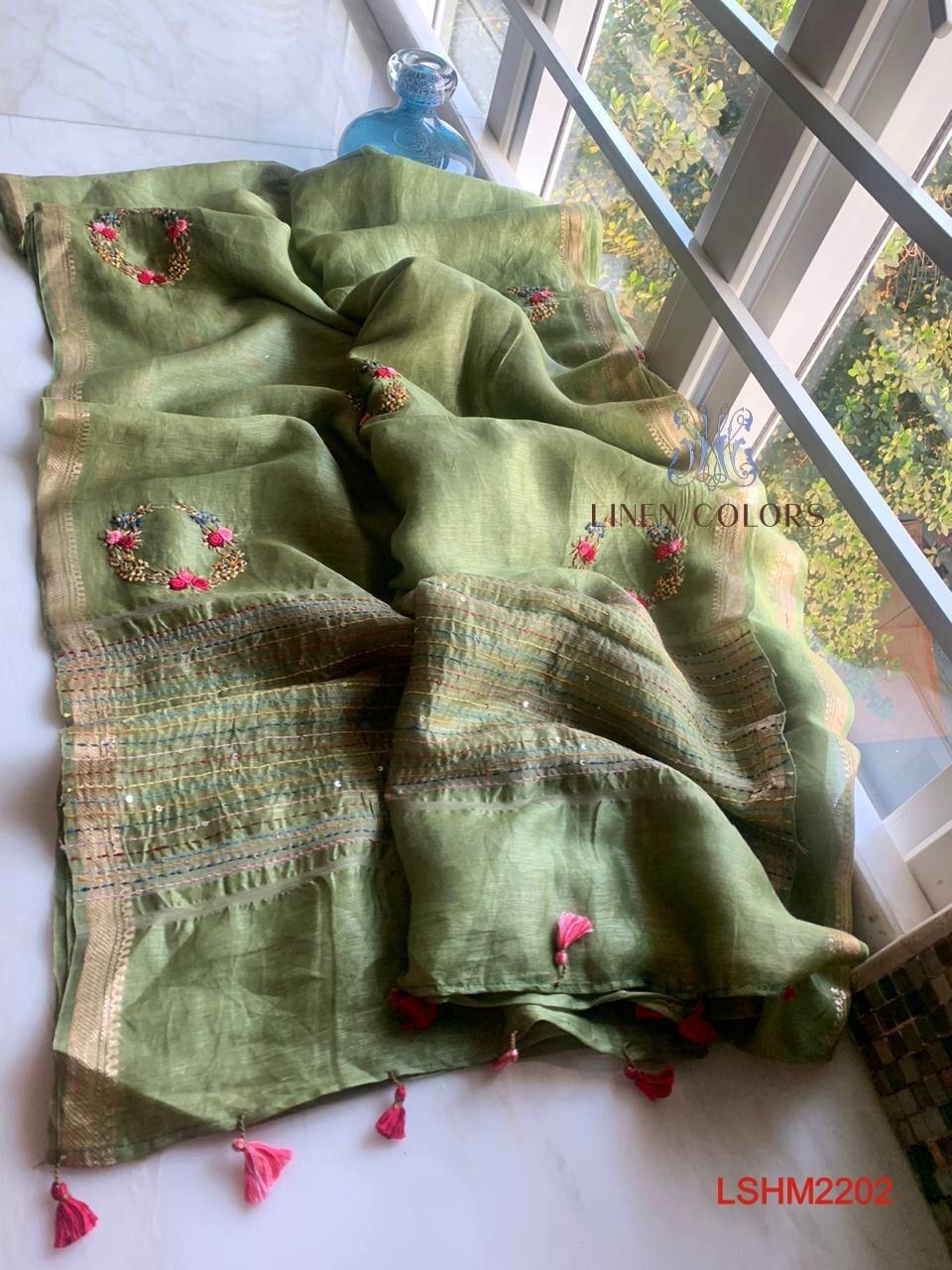 Silk by linen golden silk zari border saree with hand motifs work design