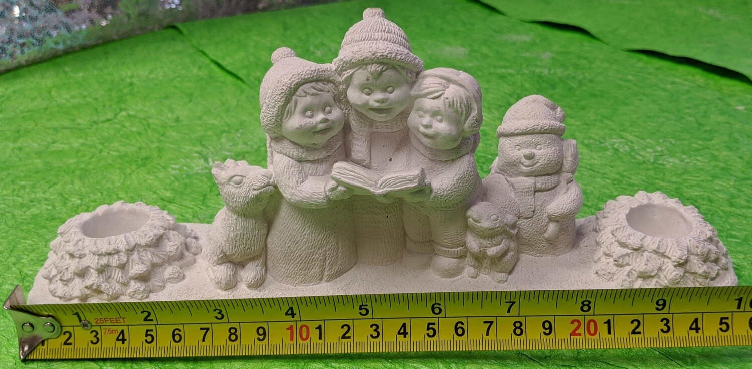 Christmas Statue Candle Holder with paints and brushes. Paint your own DIY plaster figurine Art Craft activity.