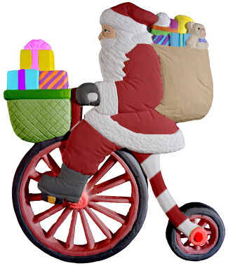 Santa on a Bicycle Santa Clause Christmas Plaque with paints and brushes. Paint your own DIY plaster figurine Art Craft activity.