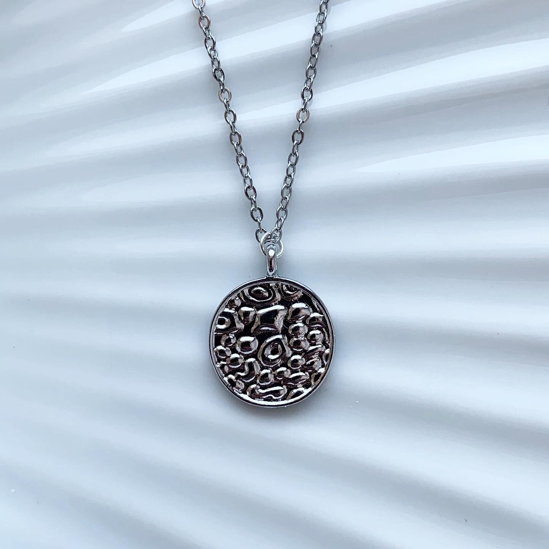 Panterprint coin ketting zilver