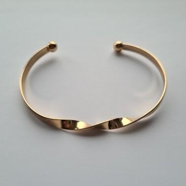 Gedraaide armband kleur goud