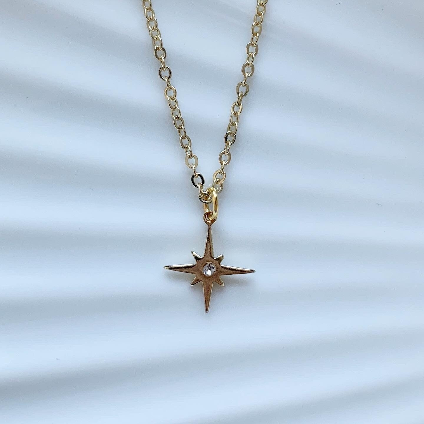 Shining star ketting goud