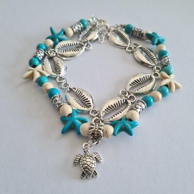 Dubbele schelp/schildpad/zeester enkelbandje blauw/wit/zilver
