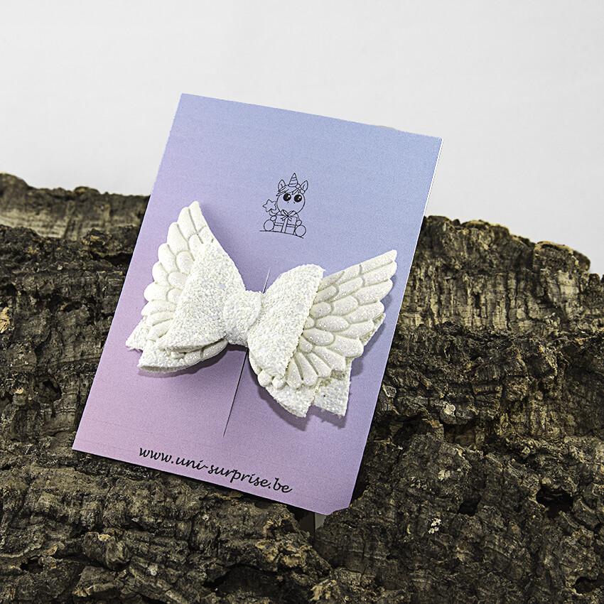 Witte glitterstrik met vleugels (1 stuk)