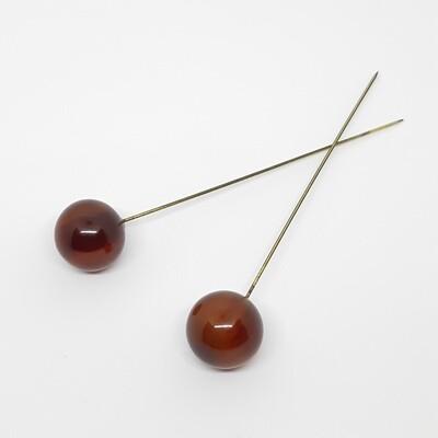 Hatpin - 2 vintage bol pinnen in amber bakelite hars