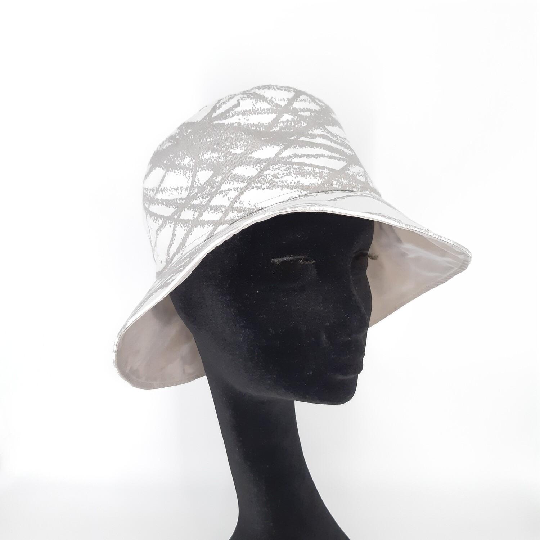 Bucket hoed met zacht taupe kriskras print