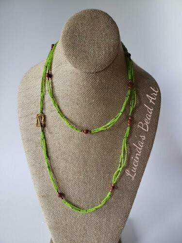 Fragile Environment Necklace - Green, goldstone, and rose gold topaz beads