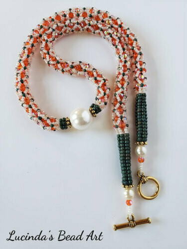 Netted Necklace in Orange, Ivory and Green with Shell Pearl Center
