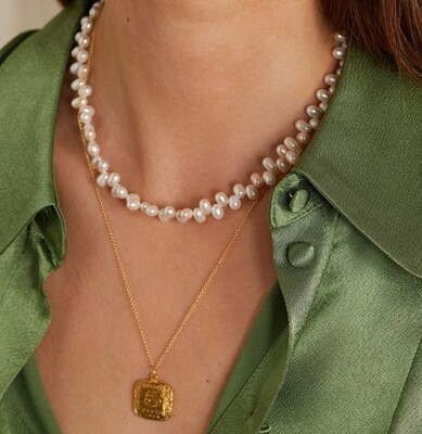Natural pearl necklace with gold plated sterling silver details