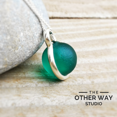 Handmade Silver Pendant with Bottle Green Glass Sphere
