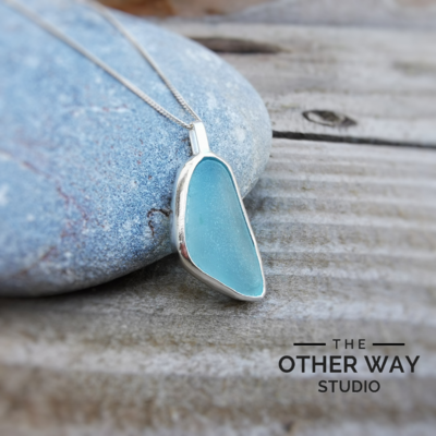 Light Aqua Sea Glass Pendant Set in Silver Bezel