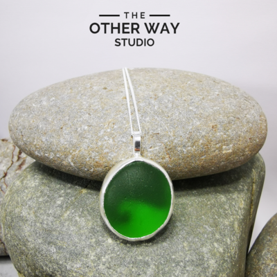 Silver Sea Glass Pendant with Wave Cutout in Bottle Green