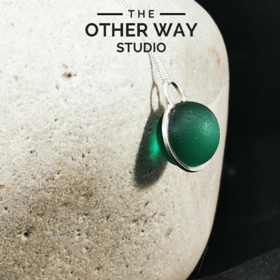 Handmade Silver Pendant with Bottle Green Glass Sphere