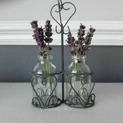 Two Miniature Bottles With A Grey Distressed Metal Holder