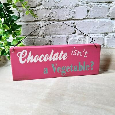 Chocolate Isn't a Vegetable? Pink Wall Plaque