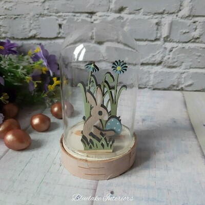 Rustic Wooden Easter Bunny With Blue Spotted Egg In A Glass Dome