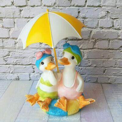 Lido Ducks Sitting On A Rubber Ring With Beach Umbrella Figurine Ornament