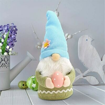 Gonk With Blue Hat Holding A Pink Spotted Egg Faceless Gnome