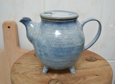 Blue teapot with legs