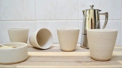 Set of four white cups