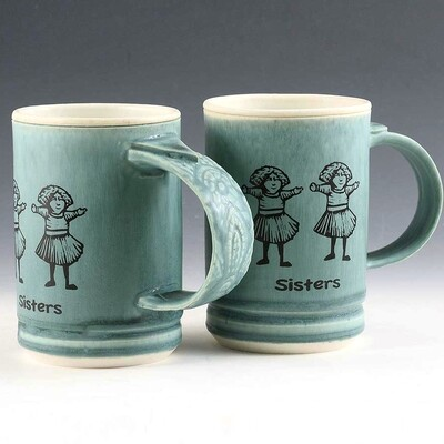 Mug - Sisters Theme. Turquoise with color-fast, fired in graphics. Porcelain