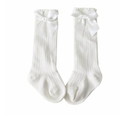 Calcetas Rayadas con Moño Blancas