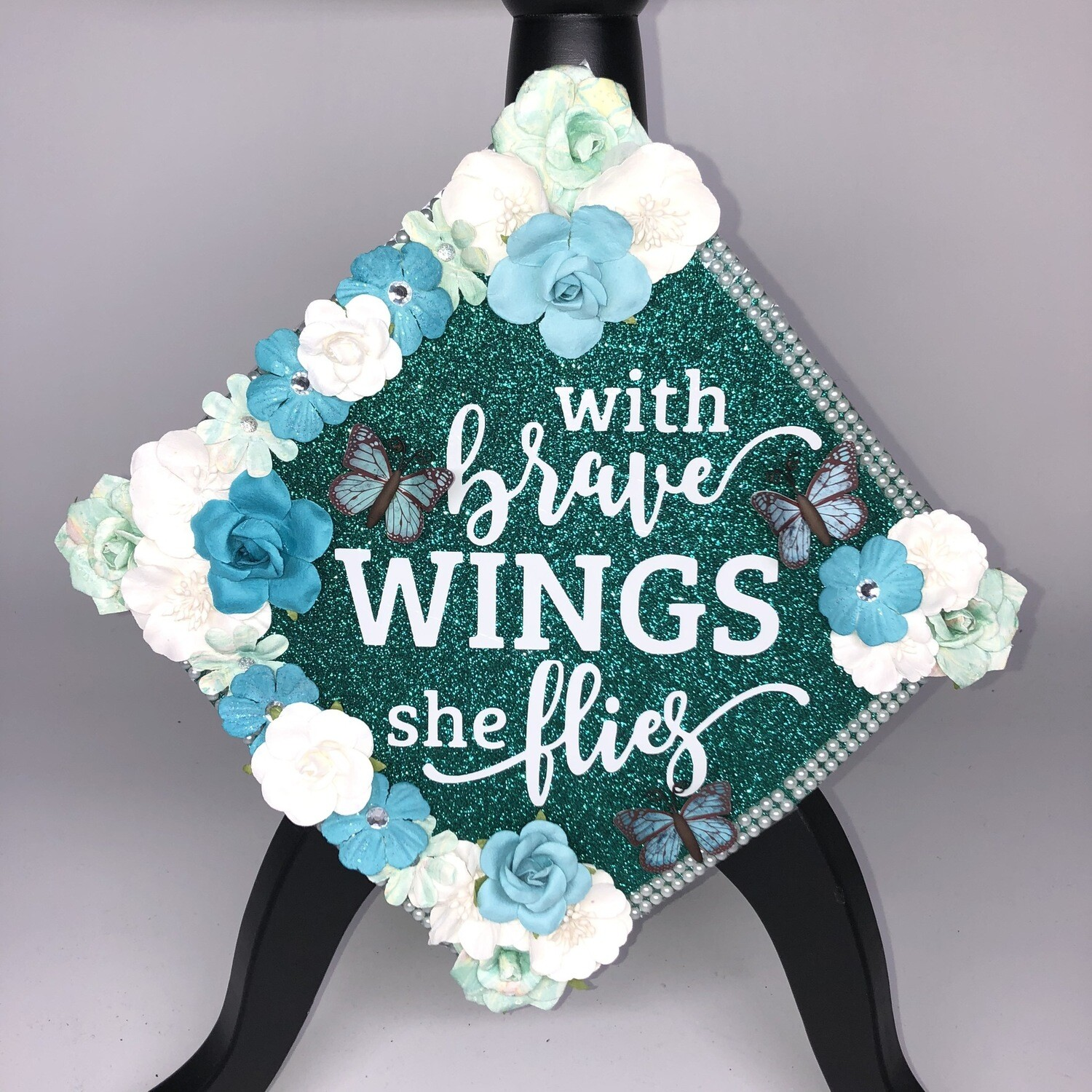 """Grad Cad Topper """"With Brave Wings She Flies"""""""