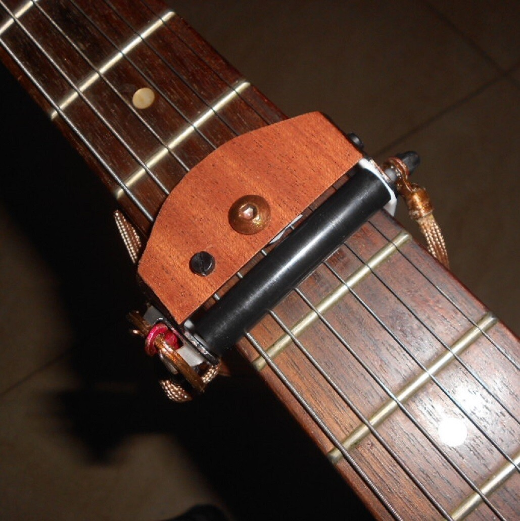 ROLLING CAPO. Brown real wood veneer finish