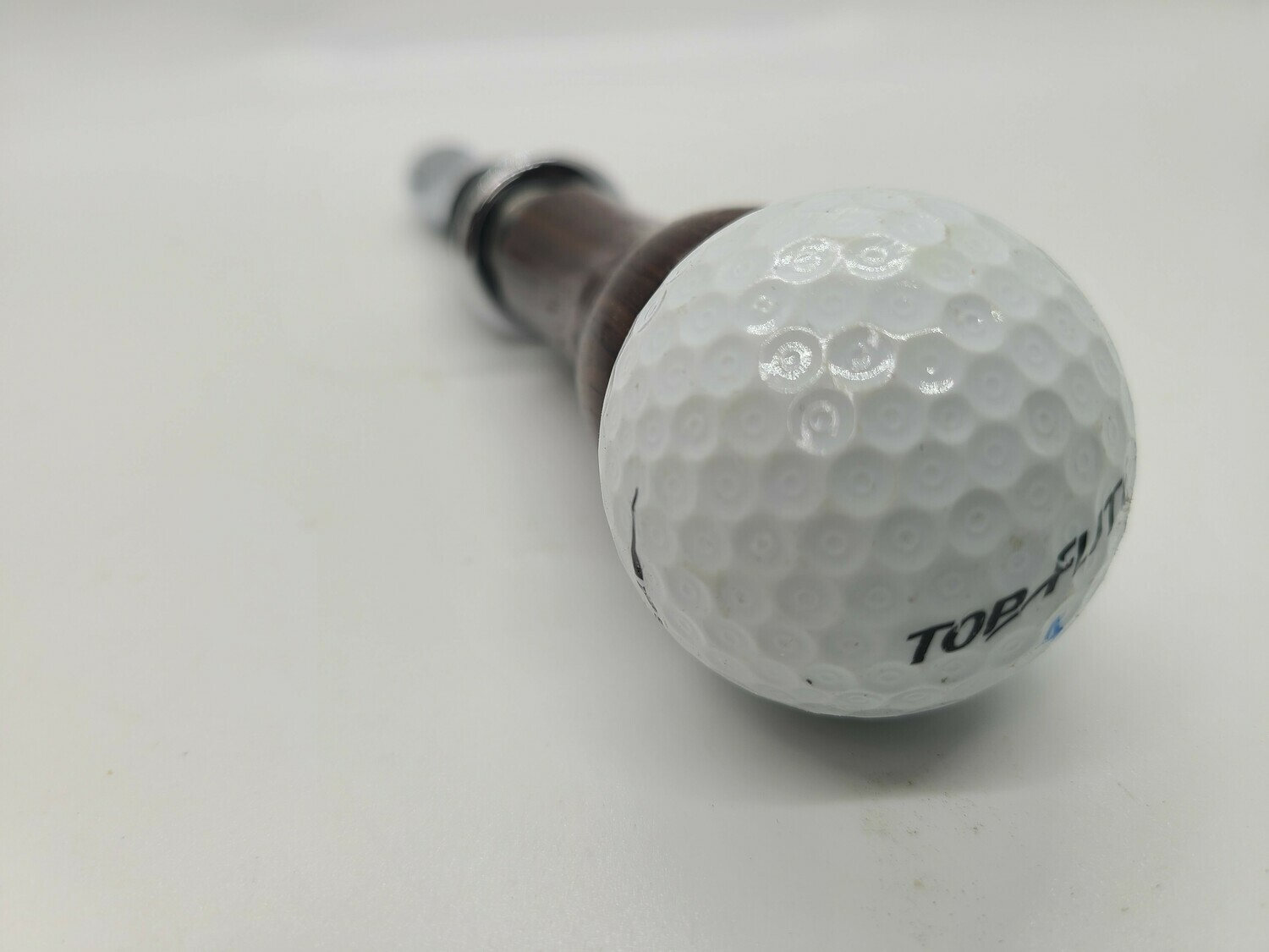 golf ball bottle stopper and corkscrew