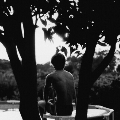 BOY BY THE POOL, PRINTED ON A 310G FINE ART COTTON PAPER, 35MM FILM