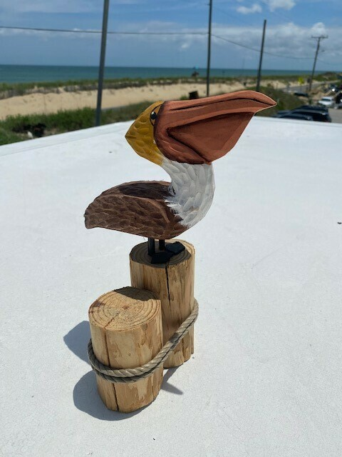 Handcrafted Wooden Pelican on Dock Pilings