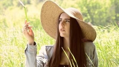 Woman in Sunhat in Field - 1